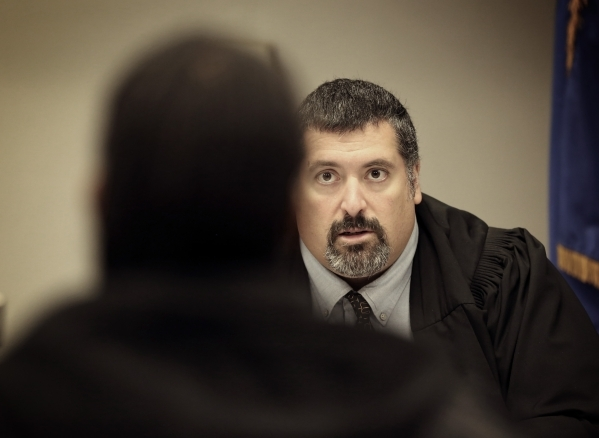 Las Vegas Justice Court Judge Joe Bonaventure conducts court  during Project Homeless Connect at Cashman Center at 850 N. Las Vegas Boulevard on Tuesday, Nov. 17, 2015. Bonaventure reduced the tra ...
