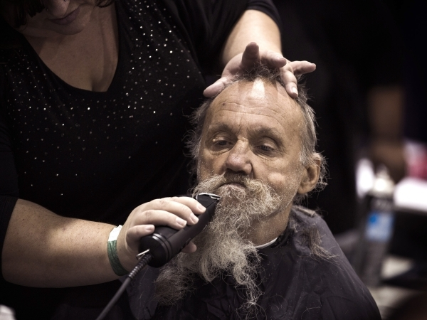 Janice Gray with Supercuts trims Lee Elliot beard during Project Homeless Connect  at  Cashman Center at 850 N. Las Vegas Boulevard on Tuesday, Nov. 17,2015. About 400 volunteers helped thousands  ...