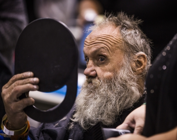 Lee Elliot looks at he hair before getting a haircut  during Project Homeless Connect  at Cashman Center at 850 N. Las Vegas Boulevard on Tuesday, Nov. 17, 2015. His last haircut was two years ago ...