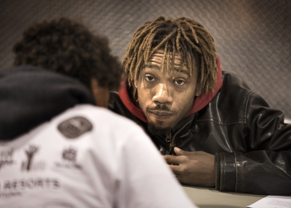 Brandon Thomas is processed by a volunteer  during Project Homeless Connect at Cashman Center at 850 N. Las Vegas Boulevard on Tuesday, Nov. 17, 2015. Thomas is looking for a job. About 400 volunt ...