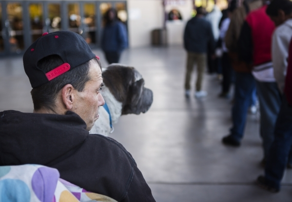 Jason Sellers sits on an electric scooter while his dog Freddie sits on his lap while waiting in line during Project Homeless Connect at Cashman Center at 850 N. Las Vegas Boulevard on Tuesday, No ...