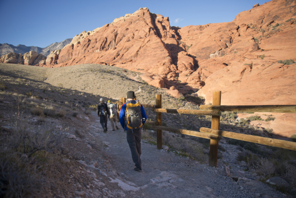 Hikers head down a trail inside the scenic loop of the Red Rock Canyon National Conservation Area on Monday, Nov. 16 2015. Red Rock is celebrating its 25th anniversary as a national conservation a ...