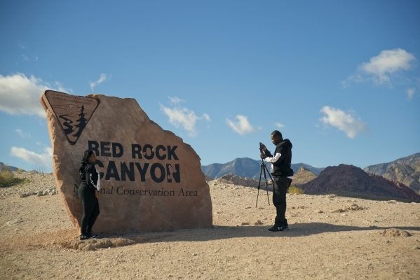 Shannon Everett has her photo taken by Mackendy Dorsainvil at the sign for the Red Rock Canyon National Conservation Area on Monday, Nov. 16 2015. Red Rock is celebrating its 25th anniversary as a ...