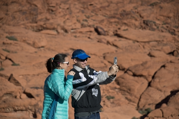Emily and Allen Levin take a photo at the Red Rock Canyon National Conservation Area on Monday, Nov. 16 2015. Red Rock is celebrating its 25th anniversary as a national conservation area. Daniel C ...