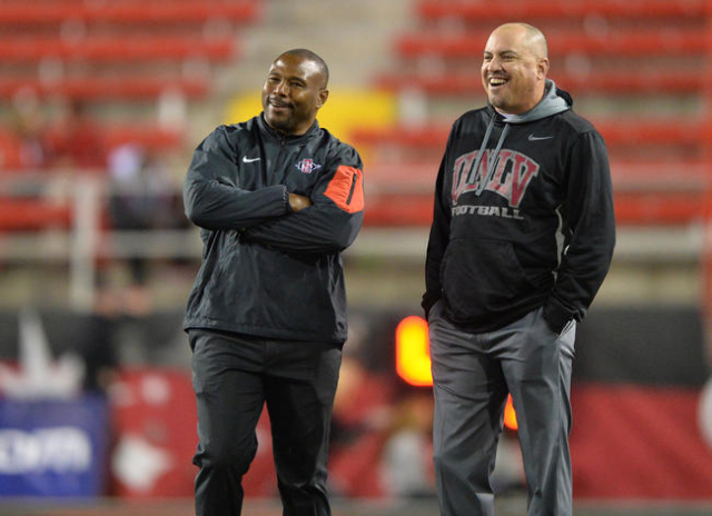 UNLV head coach Tony Sanchez speaks with a San Diego State coach during warmups before the UNLV-San Diego State game at Sam Boyd Stadium on Saturday, November 21, 2015, in Las Vegas. Brett Le Blan ...
