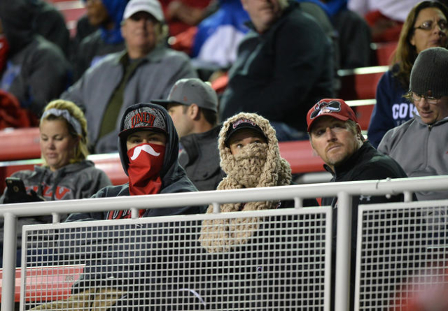 Fans try to stay warm during the San Diego State at UNLV game at Sam Boyd Stadium on Saturday, Nov. 21, 2015, in Las Vegas. San Diego State leads at the half 31-0. Brett Le Blanc/Las Vegas Review- ...