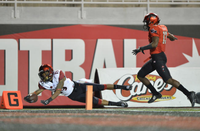 San Diego State running back Donnel Pumphrey (19) is pushed out of bounds just shy of the end zone by UNLV defensive back Tim Hough (13) at Sam Boyd Stadium on Saturday, Nov. 21, 2015, in Las Vega ...