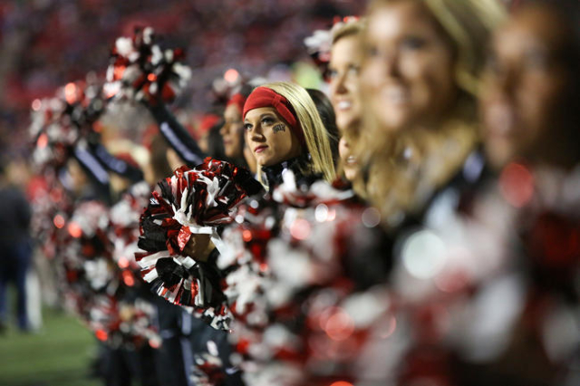 A UNLV cheer leaders looks to the video board during senior day introductions during the San Diego State at UNLV game at Sam Boyd Stadium on Saturday, November 21, 2015, in Las Vegas. San Diego St ...