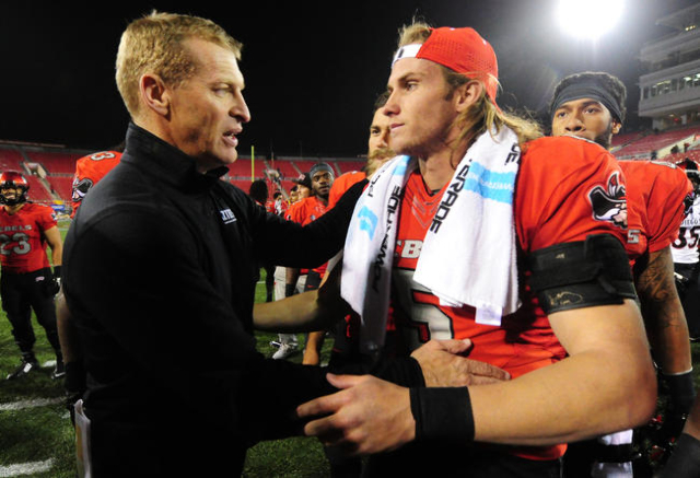Former UNLV Rebels head coach Bobby Hauck, left, shakes hands with quarterback Blake Decker at the completion of their NCAA Football game against UNLV at Sam Boyd Stadium in Henderson Saturday, No ...