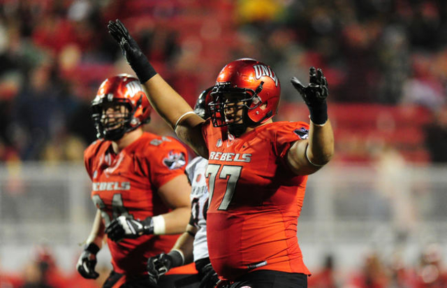 UNLV Rebels offensive lineman Nick Gstrein (77) celebrates a touchdown against San Diego State in the second half of their NCAA Football game at Sam Boyd Stadium in Henderson Saturday, Nov. 21, 20 ...