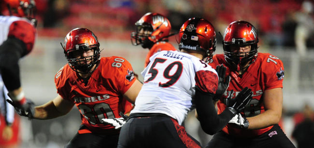 UNLV Rebels offensive linemen Kyle Saxelid (76) and Eric Noone (60) defend San Diego State Aztecs defensive lineman Kyle Kelley (59) in the second half of their NCAA Football game at Sam Boyd Stad ...