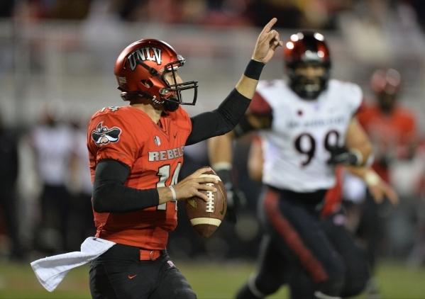 UNLV quarterback Kurt Palandech (14) points to open space against San Diego State at Sam Boyd Stadium on Saturday, Nov. 21, 2015, in Las Vegas. San Diego State leads at the half 31-0. Brett Le Bla ...
