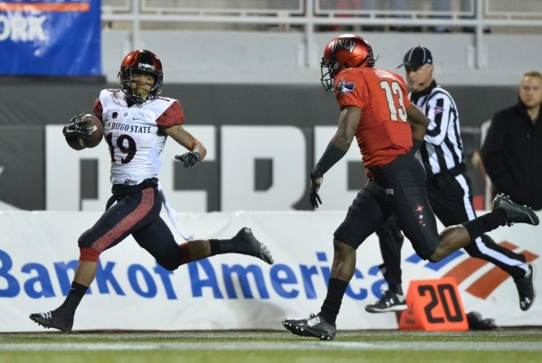 San Diego State running back Donnel Pumphrey (19) runs with the football during the UNLV-San Diego State game at Sam Boyd Stadium on Saturday, Nov. 21, 2015, in Las Vegas. San Diego State leads at ...