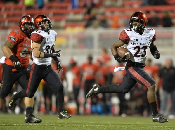 San Diego State cornerback Damontae Kazee (23) returns a punt for a touchdownduring the San Diego State at UNLV game at Sam Boyd Stadium on Saturday, November 21, 2015, in Las Vegas. San Diego Sta ...