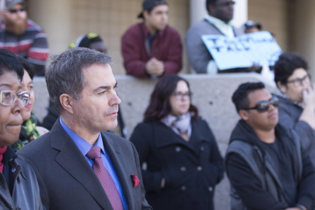 UNLV President Len Jessup, left, listens as UNLV students hold a demonstration in front of  the Franklin J. Koch Auditorium at UNLV to show support of the University of Missouri and Yale Universit ...