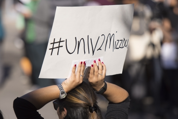 A sign is held above the crowd as UNLV students hold a demonstration in front of  the Franklin J. Koch Auditorium at UNLV to show support of the University of Missouri and Yale University in the w ...