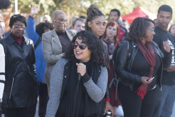 Desire Galvez, center, speaks as UNLV students hold a demonstration in front of  the Franklin J. Koch Auditorium at UNLV to show support of the University of Missouri and Yale University in the wa ...