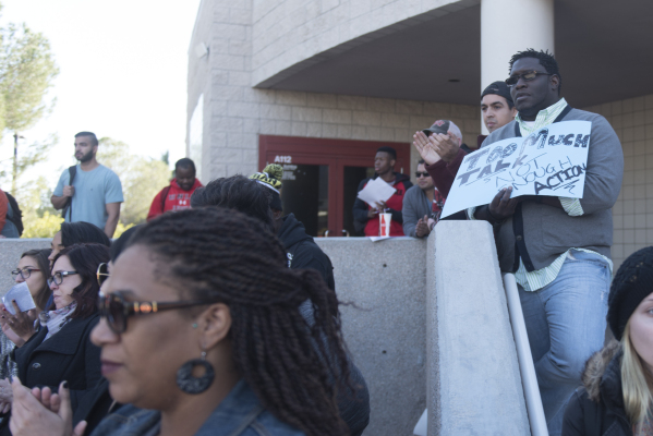 Ender Austin III, right, holds a sign as UNLV students hold a demonstration in front of  the Franklin J. Koch Auditorium at UNLV to show support of the University of Missouri and Yale University i ...