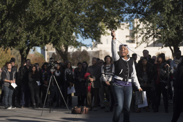 Tra Andra' Mitchell speaks as UNLV students hold a demonstration in front of  the Franklin J. Koch Auditorium at UNLV to show support of the University of Missouri and Yale University in the ...