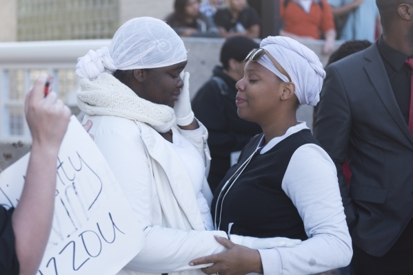 Tra Andra' Mitchell, right, holds Ashley Smith while Smith delivers an emotional speech as UNLV students hold a demonstration in front of  the Franklin J. Koch Auditorium at UNLV to show sup ...