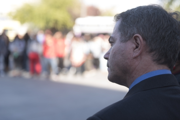 UNLV President Len Jessup listens as UNLV students hold a demonstration in front of  the Franklin J. Koch Auditorium at UNLV to show support of the University of Missouri and Yale University in th ...