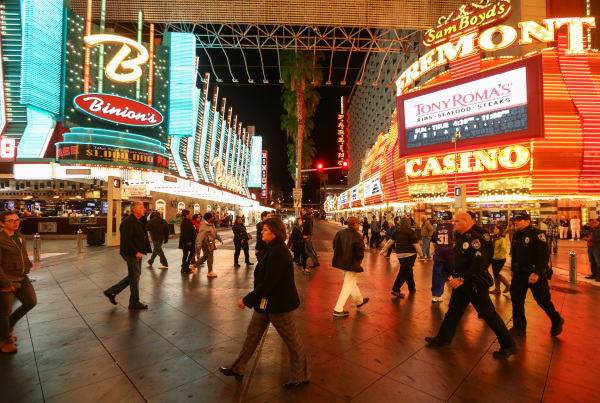 Las Vegas City Manager Betsy Fretwell, center, walks the Fremont Street Experience in downtown Las Vegas on Tuesday, Nov. 17, 2015. Tuesday was the first day of the city's new ordinance requ ...