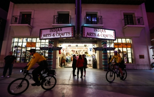 Las Vegas police officers on bikes patrol the Fremont Street Experience in downtown Las Vegas on Tuesday, Nov. 17, 2015. Tuesday was the first day of the city's new ordinance requiring stree ...