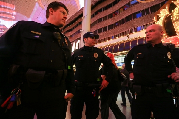 Las Vegas city marshals patrol the Fremont Street Experience in downtown Las Vegas on Tuesday, Nov. 17, 2015. Tuesday was the first day of the city's new ordinance requiring street performan ...