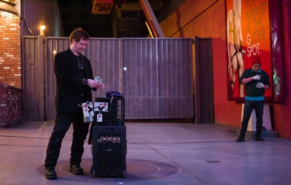 Magician Sean Scott, left, sets up at a new location zone on the Fremont Street Experience in downtown Las Vegas on Tuesday, Nov. 17, 2015. Tuesday was the first day of the city's new ordina ...