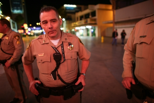 Las Vegas police captain Andrew Walsh is shown around the Fremont Street Experience in downtown Las Vegas on Tuesday, Nov. 17, 2015. Tuesday was the first day of the city's new ordinance req ...