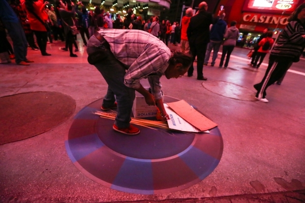 A street performer arrives at a new location zone on the Fremont Street Experience in downtown Las Vegas on Tuesday, Nov. 17, 2015. Tuesday was the first day of the city's new ordinance requ ...