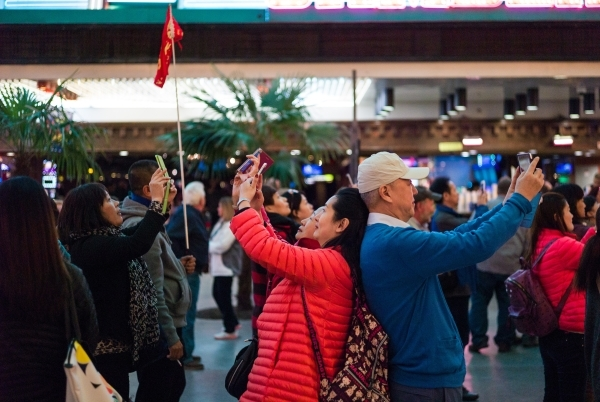 People take photos on the Fremont Street Experience in downtown Las Vegas on Tuesday, Nov. 17, 2015. Tuesday was the first day of the city's new ordinance requiring street performances to st ...