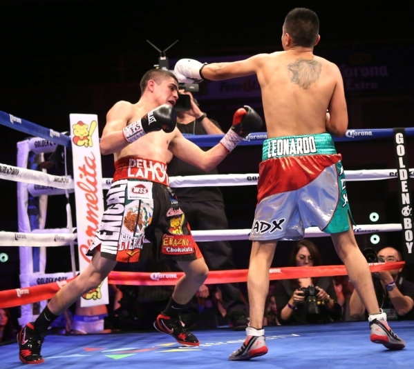 Diego De La Hoya, left, moves away from a punch against Giovanni Delgado in their featherweight boxing bout at the Hard Rock casino-hotel in Las Vegas Friday, Nov. 20, 2015. Diego De La Hoya won b ...