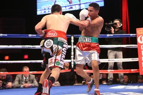 Diego De La Hoya, left, lands a right punch against Giovanni Delgado in their featherweight boxing bout at the Hard Rock casino-hotel in Las Vegas Friday, Nov. 20, 2015. Diego De La Hoya won by un ...