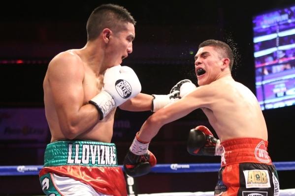 Giovanni Delgado, left, lands a left punch against Diego De La Hoya in their featherweight boxing bout at the Hard Rock casino-hotel in Las Vegas Friday, Nov. 20, 2015. Diego De La Hoya won by una ...