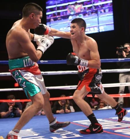 Giovanni Delgado, left, battles against Diego De La Hoya in their featherweight boxing bout at the Hard Rock casino-hotel in Las Vegas Friday, Nov. 20, 2015. Diego De La Hoya won by unanimous deci ...
