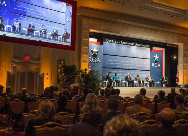 """A video screen projects  a panel discussion  titled """"2016 and the role of Republican Governors"""" during the Republican Governors Association conference at Encore on Wednesday, Nov. 18,201 ..."""