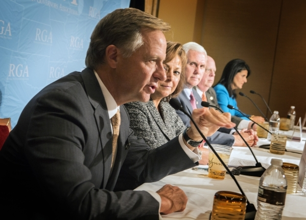 Republican Governors Association  Chairman Gov. Bill Haslam, left, Tennessee, speaks during a press conference along with RGA Vice Chair Gov. Susana Martinez, New Mexico Gov. Mike Pence, Indiana G ...