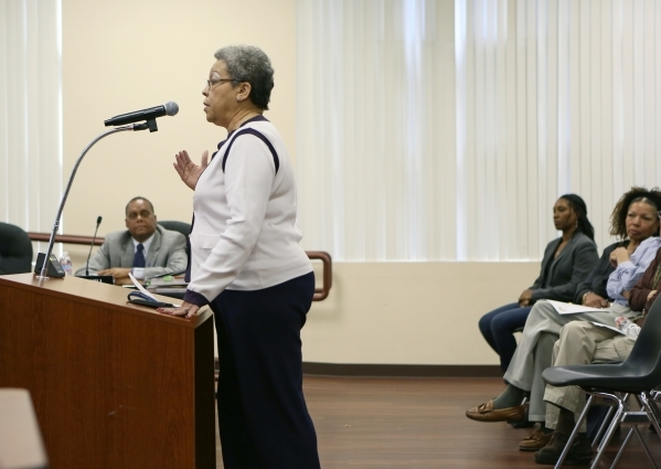 Southern Nevada Regional Housing Authority employee Mildred Lockhart, center, speaks to the board about executive director John Hill, left, during public comment at a SNRHA board meeting at Howard ...