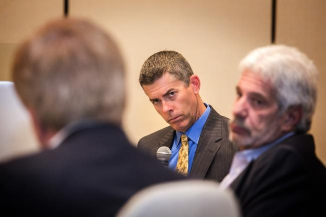 Glenn Cook, center, Senior Editorial writer and Viewpoints columnist for the Las Vegas Review-Journal listens while Sig Rogich, president of The Rogich Communications Group answers a questiondurin ...