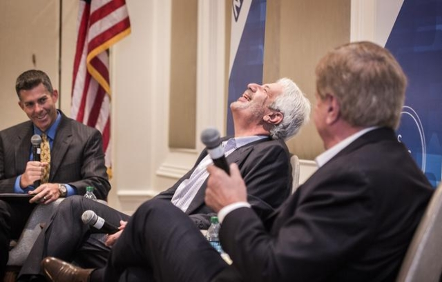 Billy Vassiliadis, center, CEO and principal of R&R Partners, laughs after Sig Rogich, president of The Rogich Communications Group, talks about challenges of the Nevada Republican party durin ...