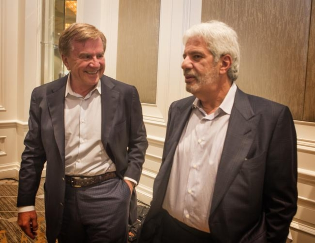 Sig Rogich, left, president of The Rogich Communications Group, and Billy Vassiliadis,  CEO and principal of R&R Partners, chat  during  Newsfeed at the Four Seasons on Wednesday, Nov. 18,2015 ...