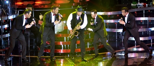 "Human Nature -- from left, Phil Burton, Toby Allen, Mike Tierney and Andrew Tierney -- performs with saxophonist Tommy Alvarado during the group's ""Christmas, Motown and More"" show ..."