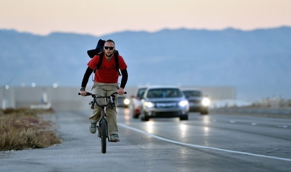 A bicyclist rides along Executive Airport Drive in Henderson on Friday, Nov. 20, 2015. David Becker/Las Vegas Review-Journal
