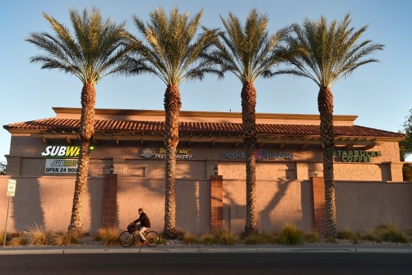 A bicyclist rides on the sidewalk along West Horizon Ridge Parkway in Henderson on Friday, Nov. 20, 2015. David Becker/Las Vegas Review-Journal
