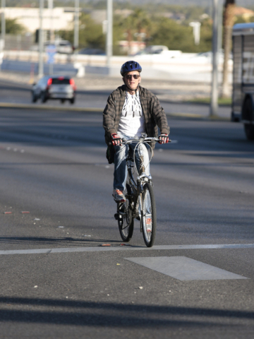 Bicycle commuter Max Maddux rides Green Valley Parkway in Henderson on Friday, Nov. 20, 2015. The City of Henderson was recently awarded a silver-rating from a bicycle safety advocate group. Donav ...