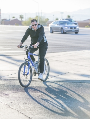 An unidentified cyclist rides along St. Rose Parkway in Henderson on Thursday, Nov. 19, 2015. The City of Henderson was recently awarded a silver-rating from a bicycle safety advocate group. Donav ...