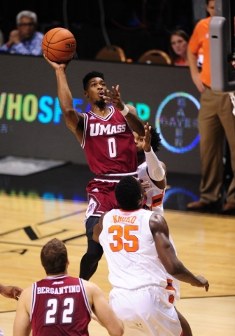 Massachusetts Minutemen guard Donte Clark (0) goes up for a layup against Clemson in the first half of their NCAA basketball game at the MGM Grand Garden Arena in Las Vegas  Monday, Nov. 23, 2015. ...