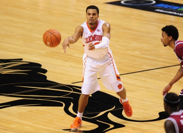 Clemson Tigers guard Avry Holmes (12) passes in the second half of their NCAA basketball game against Massachusetts at the MGM Grand Garden Arena in Las Vegas  Monday, Nov. 23, 2015. Josh Holmberg ...