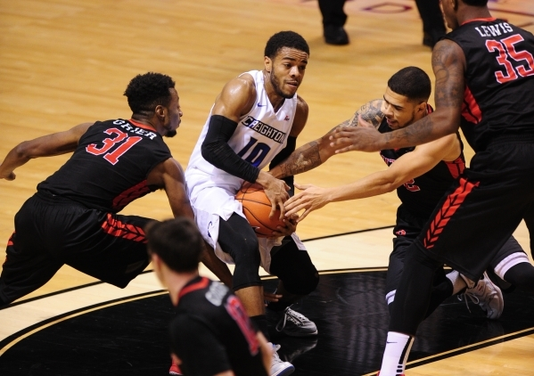 Creighton point guard Mo Watson Jr. (10) protects the ball from Rutgers guards Bishop Daniels, right, and Omari Grier (32) in the first half of their NCAA Basketball game at the MGM Grand Garden A ...